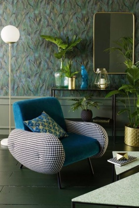 a mid-century modern chair with a teal back and seat, gingham armrests and metallic legs is a stylish mid-century statement