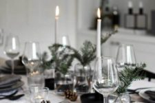 17 a modern Nordic Christmas table with grey plates, candles, evergreens and pinecones is all-natural and welcoming