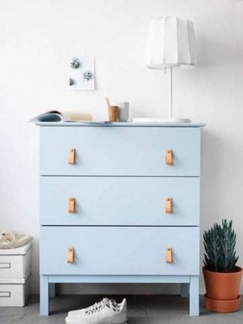a trendy powder blue Tarva dresser with leather handles is a chic idea for a boho or contemporary space