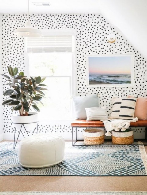 bright polka dot printed wallpaper is paired with more neutral and simple geometric prints and stripes