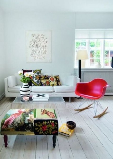 a mismatched upholstery ottoman and bright pillows spruce up the whole neutral room at once