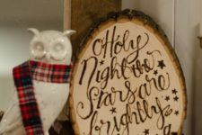 18 a rough wood slice Christmas sign with woodburnt words looks chic and cozy and can be used for rustic decor
