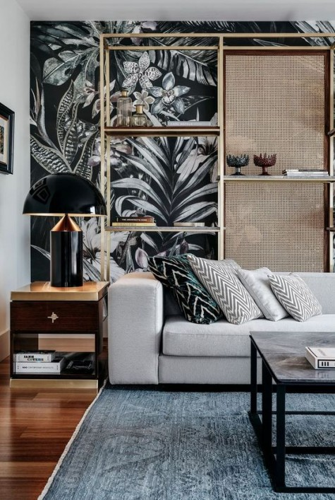 dramatic moody wallpaper takes over the space and chevron pillows on the sofa make the space cooler