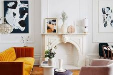 19 a more contemporary version of a fireplace matches the mid-century modern Parisian living room