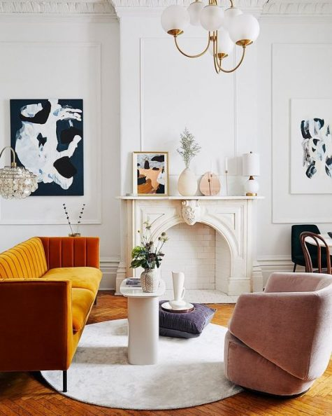 a more contemporary version of a fireplace matches the mid-century modern Parisian living room