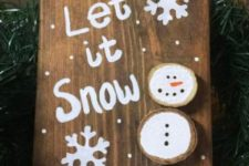 19 a simple wooden sign with a wood slice snowman is a cute decoration that can be DIYed by your kids