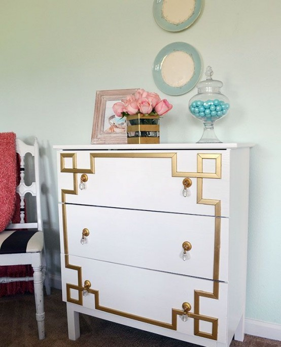 a vintage-inspired Tarva dresser with gold inlays and gold and crystal pulls for a touch of art deco