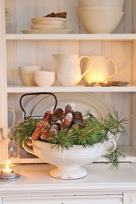 a vintage soup bowl with evergreens and pinecones is a nice Christmas centerpiece with a refined feel