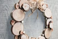 21 a wood slice Christmas wreath is a cool way to add a rustic feel to your space and won't take uch effort to make