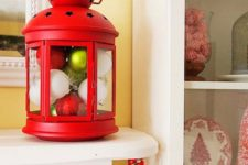 21 an IKEA ROTERA lantern filled with Christmas ornaments is a bright and very simple Christmas decoration