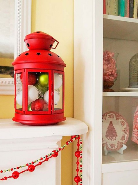 an IKEA ROTERA lantern filled with Christmas ornaments is a bright and very simple Christmas decoration