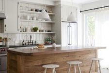 21 an off-white kitchen and a wood plank kitchen island that adds warmth to the space and contrasts its style