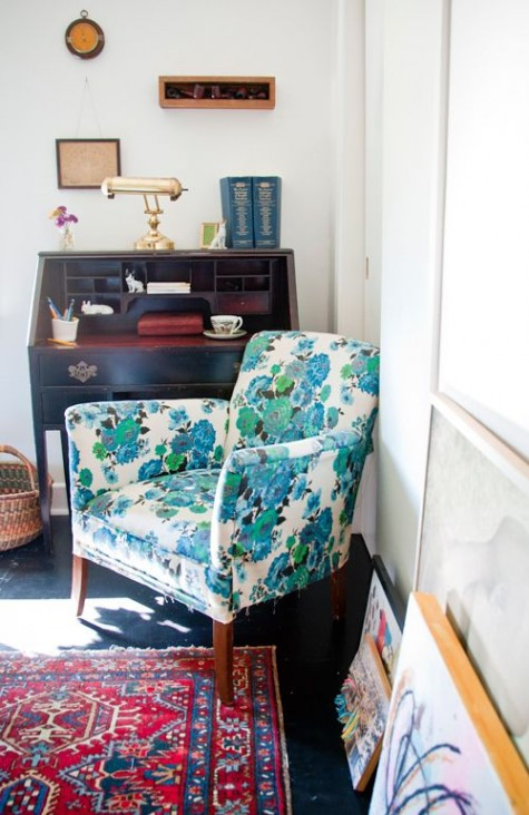 a bright floral chair and a bold printed rug make this little nook veyr bold and very eye-catching