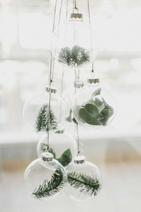 minimalist Christmas ornaments – sheer glass ones with fresh greenery and evergreens feel very natural