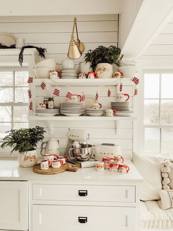 retro farmhouse Christmas kitchen styling with Santa mugs, mini mitten garland and evergreen arrangements
