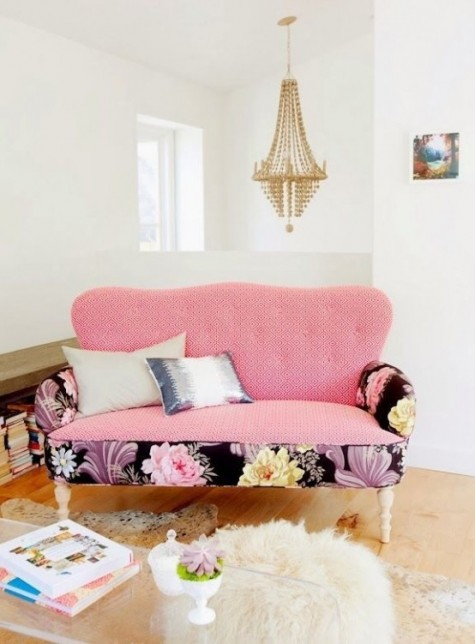 a cute pink loveseat spruced up with dark floral armrests and a pink seat and back is perfect for a feminine space