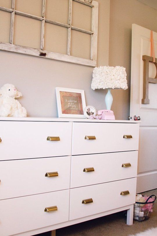 a white Tarva hack with vintage metal knobs is a stylish idea with a touch of retro