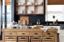 24 a contemporary kitchen and a rustic vintage wooden kitchen island on casters and with crate drawers for food