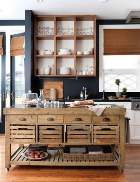 a contemporary kitchen and a rustic vintage wooden kitchen island on casters and with crate drawers for food