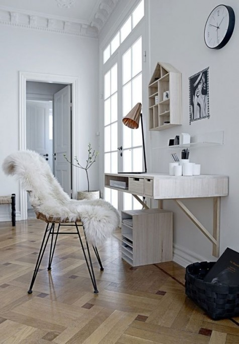 a whitewashed floating desk with some drawers and a matching house-shaped shelf for a Scandinavian workspace