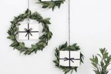 24 minimalist Christmas wreaths with white gift boxes inside hanging on the wall are super cool