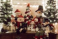 24 vintage Christmas decor with Christmas trees in burlap, pinecones, snowmen toys and a lit up Christmas sign