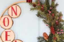 25 a wood slice, evergreens and pinecone Christmas wreath with a plaid ribbon is a stylish and cool idea