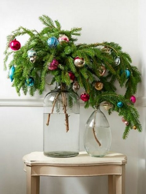 evergreen branches with colorful Christmas ornaments placed into jars are bold holiday decorations and centerpieces