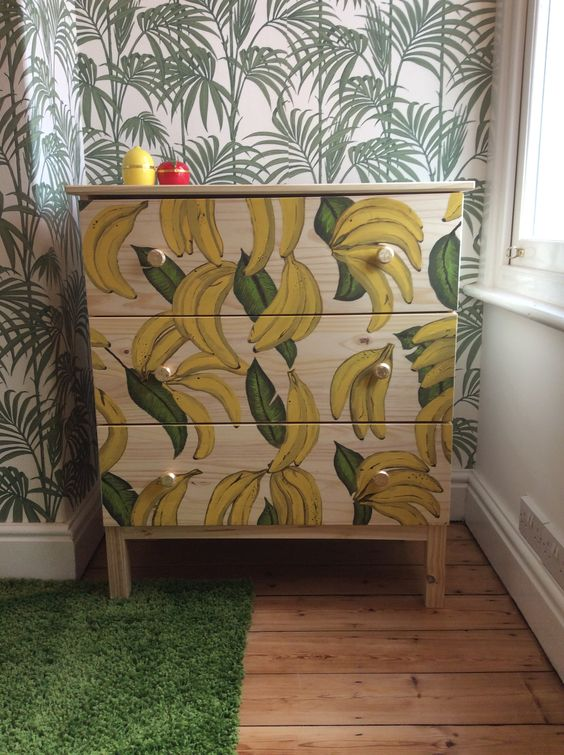 an IKEA Tarva hack with painted bananas and gold knobs is a playful and whimsy item for storage