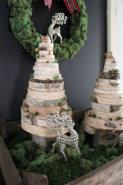 such wood slice Christmas trees can be DIYed easily and displayed with moss is a great holiday composition you can make