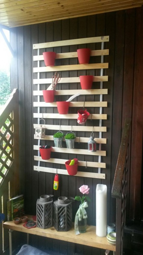 an IKEA Lattenrost balcony hack allows hanging lanterns and planters, you can make a real vertical garden