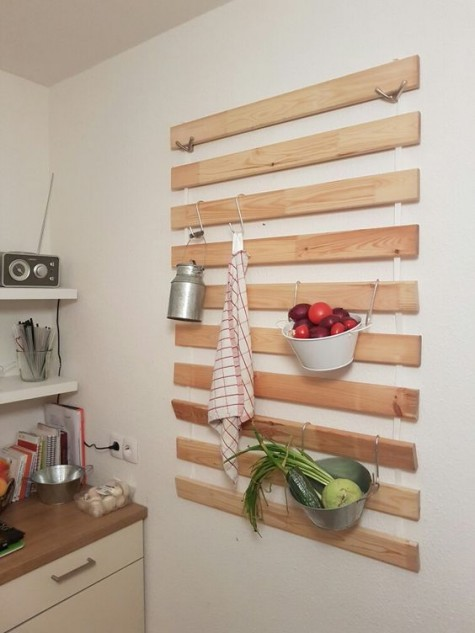 an IKEA Lattenrost kitchen hack with hooks for hanging all kinds of stuff