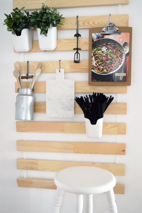 an IKEA Luroy hack for a kitchen with utensil and cutlery holders, a notebook and some planters attached