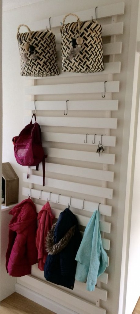 an IKEA Luroy hack im white for an entryway features hooks, baskets and some storage for keys