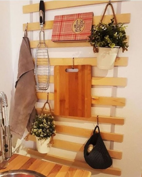 an IKEA Luroy slatted bed base turned into a cool kitchen item with hooks and hangers