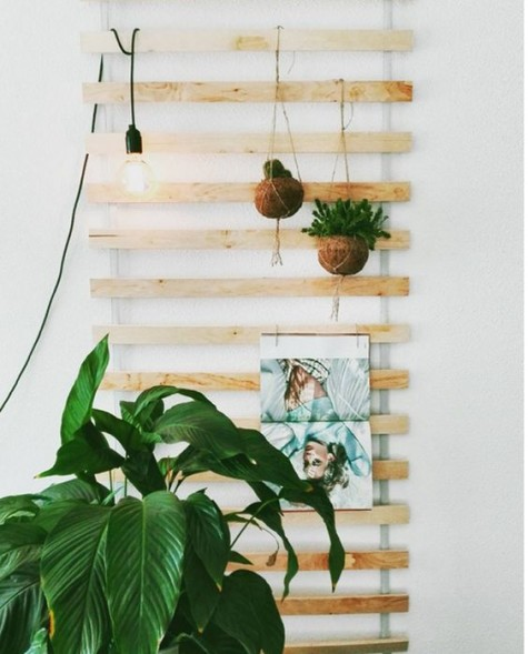 an IKEA bed slat hack with hanging planters, a pendant lamp is great for simple open storage