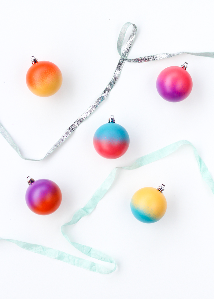 DIY color blocked spray painted Christmas ornaments (via thecraftedlife.com)