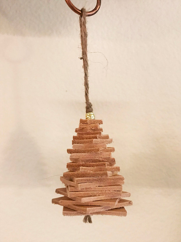 DIY leather Christmas tree ornament with a shiny bead (via navonahandmade.com)