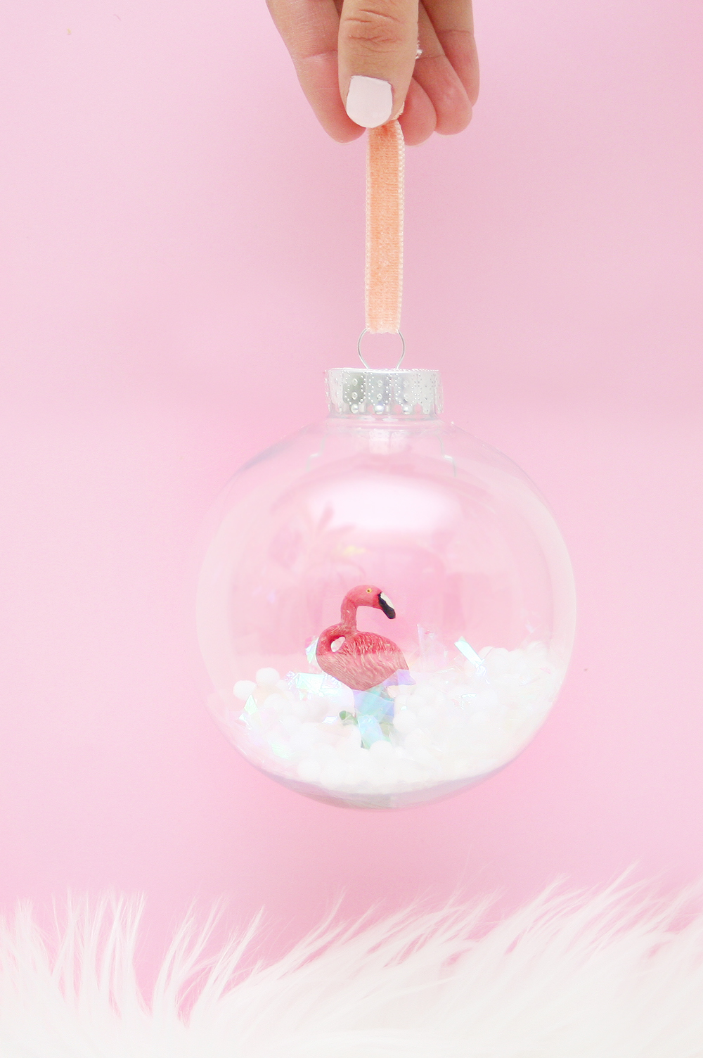 DIY snow glove Christmas ornament with a pink flamingo