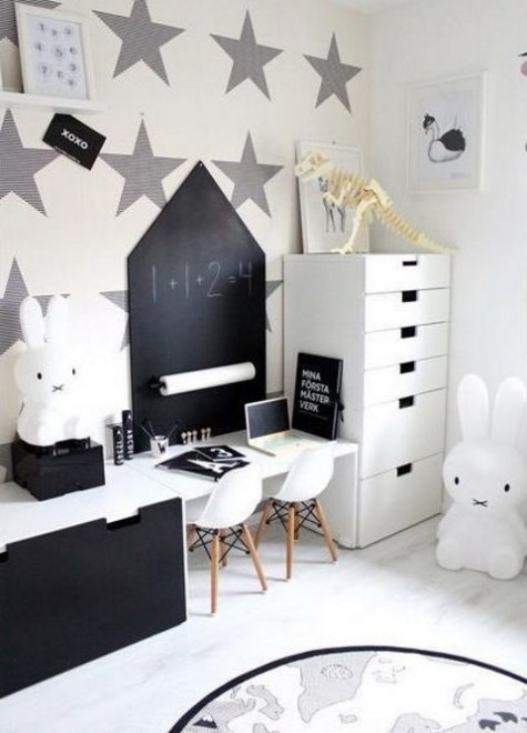 a black and white Scandi kids' space with a desk and much storage is fully done with IKEA Stuva units