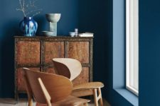 02 a classic blue room warmed up with rich-colored wooden furniture and highlighted with bold blue touches