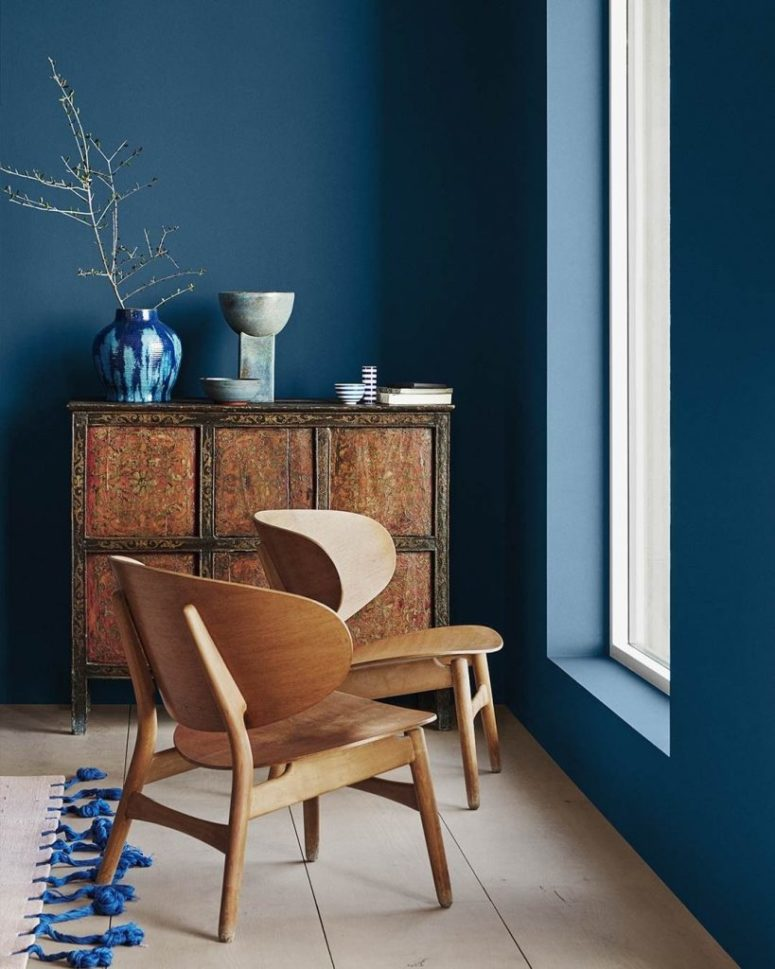 a classic blue room warmed up with rich-colored wooden furniture and highlighted with bold blue touches
