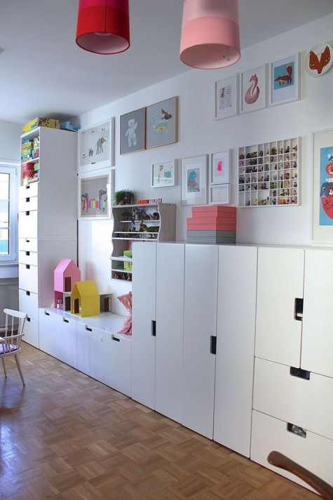 a large kids' playroom fully done with IKEA Stuva cabinets and drawers is very functional
