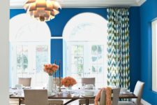 03 a refined dining room with classic blue walls and a domed ceiling looks outstanding and very cheerful