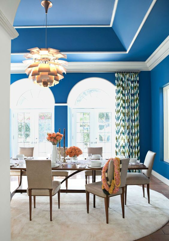 a refined dining room with classic blue walls and a domed ceiling looks outstanding and very cheerful
