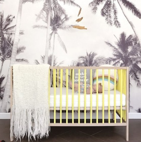 an IKEA Sniglar crib painted bright - add a touch of sunny color to your nursery with such a crib