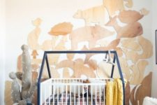 04 DIY IKEA Gulliver crib hack with a house-shaped frame looks very cozy and very welcoming
