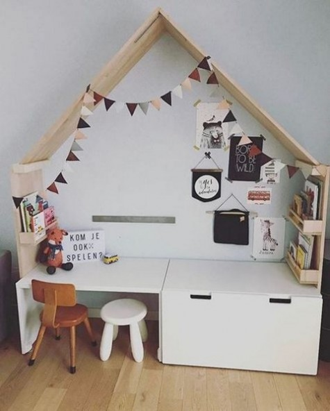 a stylish IKEA Stuva hack   a cabinet received an additional mini desk for a creative kids' nook