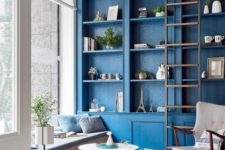 04 paint your built-in furniture unit in classic blue to make it stand out in the space and bring a touch of trend here