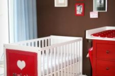 06 an IKEA Sundvik cot with a colorful fabric accent with the baby's name is a cute way to personalize the space